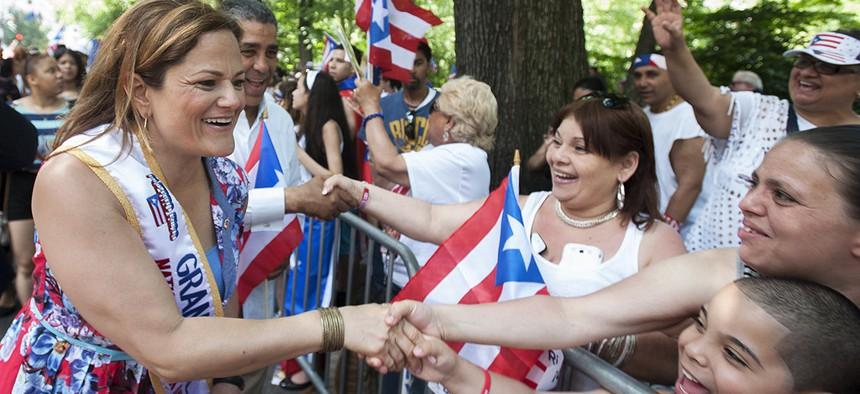 Then-New York City Council Speaker Melissa Mark-Viverito greets onlookers at the Puerto Rican Day Parade in 2014.