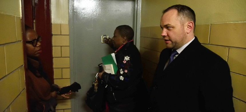 New York City Council Speaker Corey Johnson touring a NYCHA development in April.