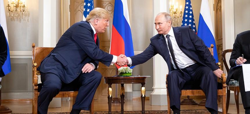 President Donald Trump shakes the hand of Russian President Vladimir Putin in Helsinki, Finland.