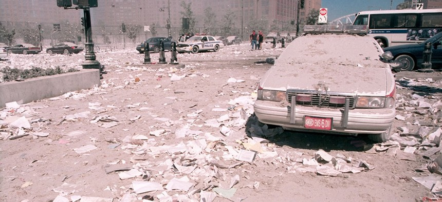 Ash covers an emergency vehicle as it lies near the area known as Ground Zero, following the collapse of the Twin Towers.