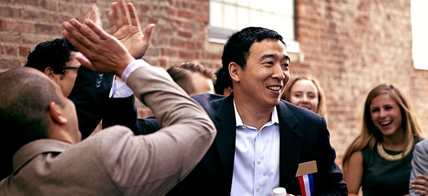 Presidential hopeful Andrew Yang surrounded by supporters.