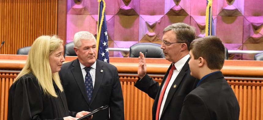Assemblyman Brian Miller being sworn in.