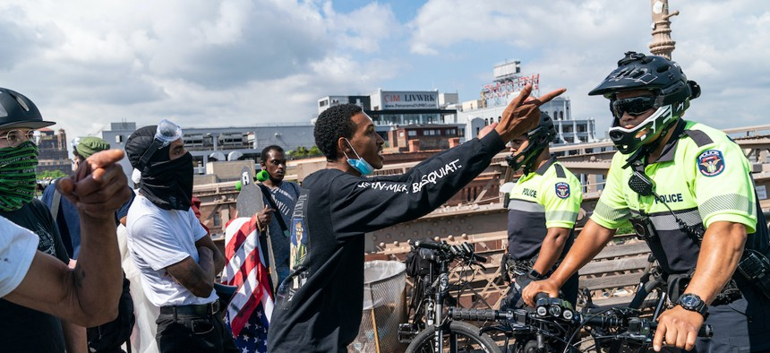 Black Lives Matter protestors confronted by the NYPD on the Brooklyn Bridge on July 15th.
