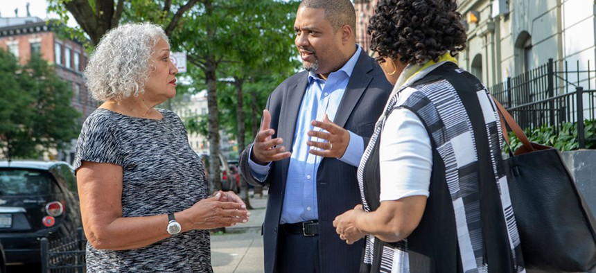 New York Law professor Alvin Bragg speaking with supporters.