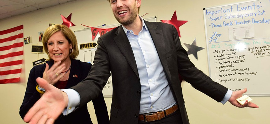 Eric Trump, right, son of President Donald Trump, enters a rally for U.S. Rep. Claudia Tenney at her campaign headquarters in New Hartford.
