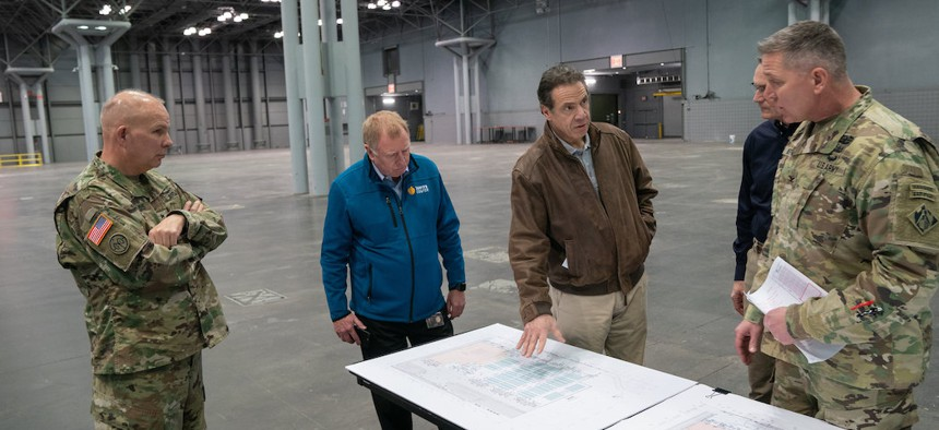 Cuomo discusses coronavirus combat plans with Colonel Thomas Asbury, Major General Patrick Murphy, and Major General Raymond Shields.