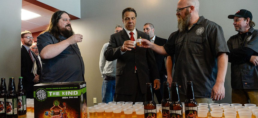 Governor Cuomo cutting the ribbon at Three Heads Brewing in Rochester in 2016.