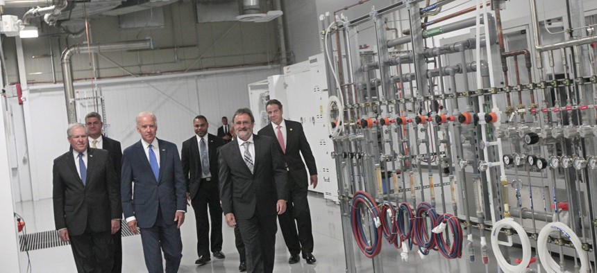 Former Vice President Joe Biden and Gov. Andrew Cuomo tour SUNY Poly during the announcement that the federal government would join the state in funding the American Institute for Manufacturing Integrated Photonics in Rochester in 2015.