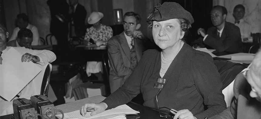 Former Secretary of Labor Frances Perkins testifying to Congress for the wage-and-hour bill, to eliminate sweatshop conditions, in June, 1937.
