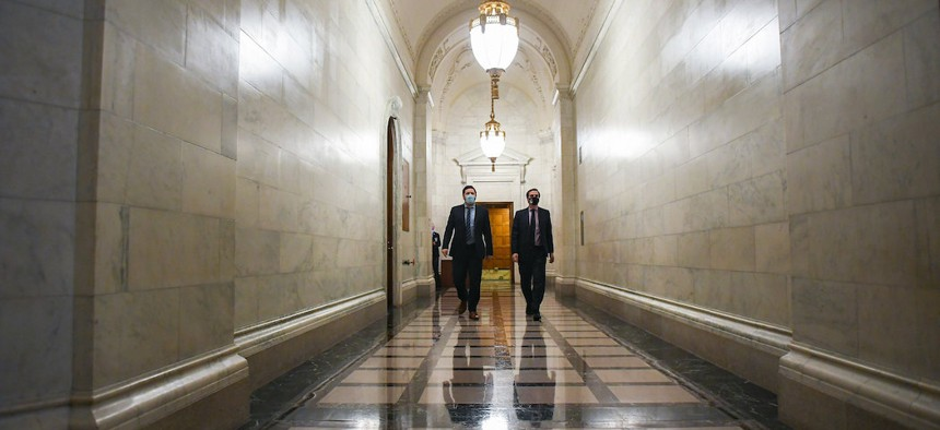 New York State Senate Deputy Majority Leader Michael Gianaris (right) and NYS Senate Deputy Counsel Eric Katz walk to the Senate chamber after a rules meeting during session on June 10th.