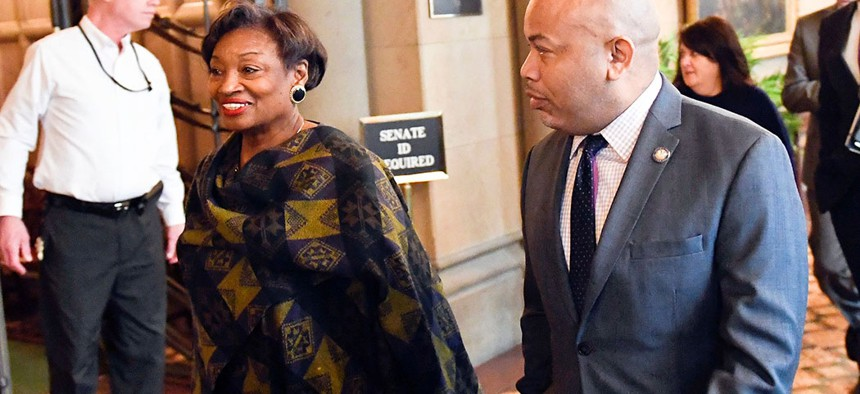 Senate Majority Leader, Andrea Stewart-Cousins and Assembly Speaker Carl Heastie walk past the Senate Chamber in Albany, N.Y