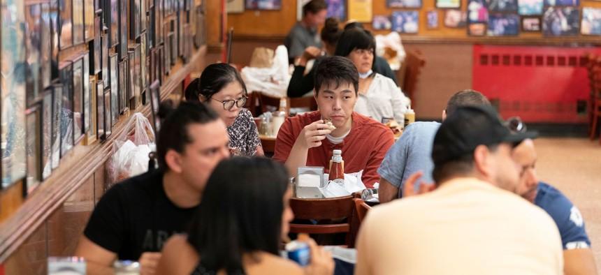 People dining indoors at Katz Delicatessen on September 30, 2020.