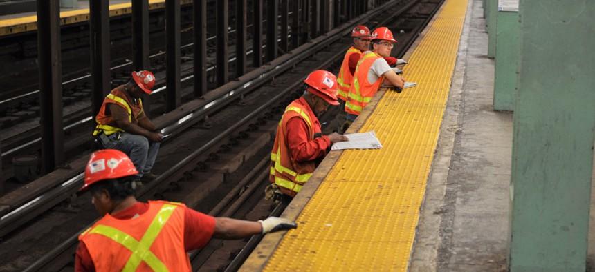 MTA workers repairing subway tracks