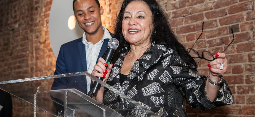 Betty Rosa, chancellor of the state Board of Regents, next to Jeff Meija, Manhattan Center for Science and Mathematics graduate.
