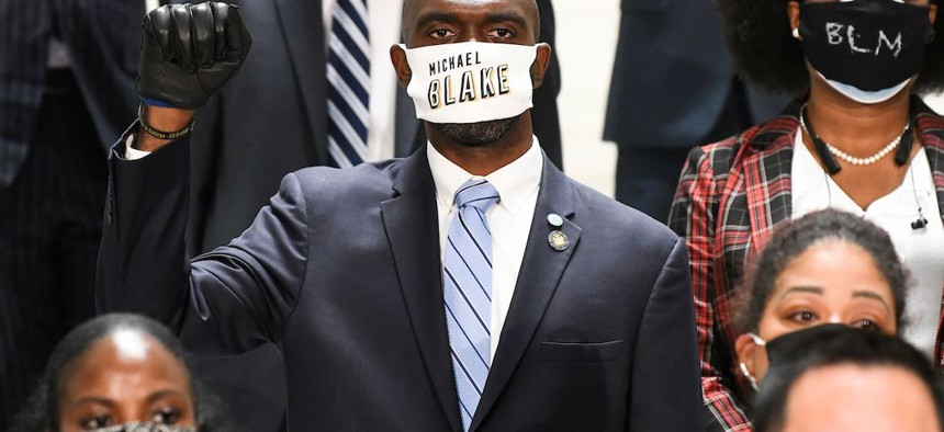 Assembly Member Michael Blake stands in solidarity with Assembly members in favor of new legislation for Police Reform during a news briefing at the state Capitol, in Albany on June 8th.