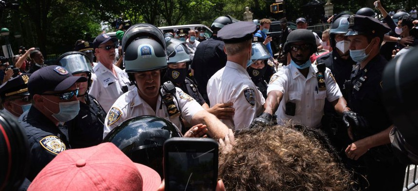 Black Lives Matter protesters and NYPD officers have a confrontation near City Hall Park.