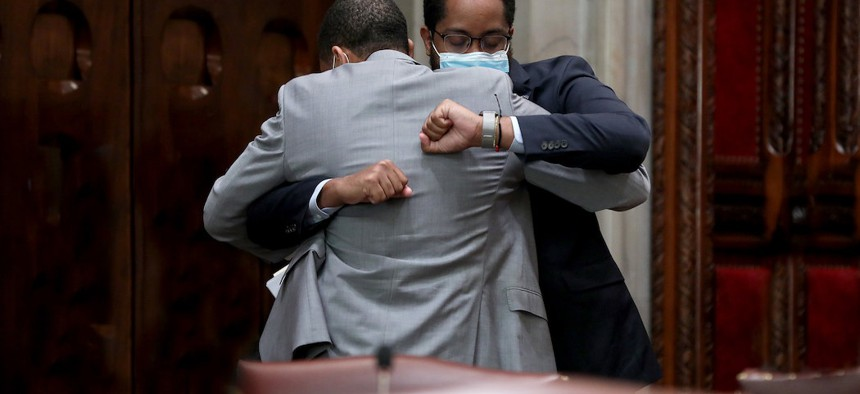 NYS Senator Jamaal Bailey hugs NYS Senator Zellnor Myrie after passing the bill to repeal Section 50-A.
