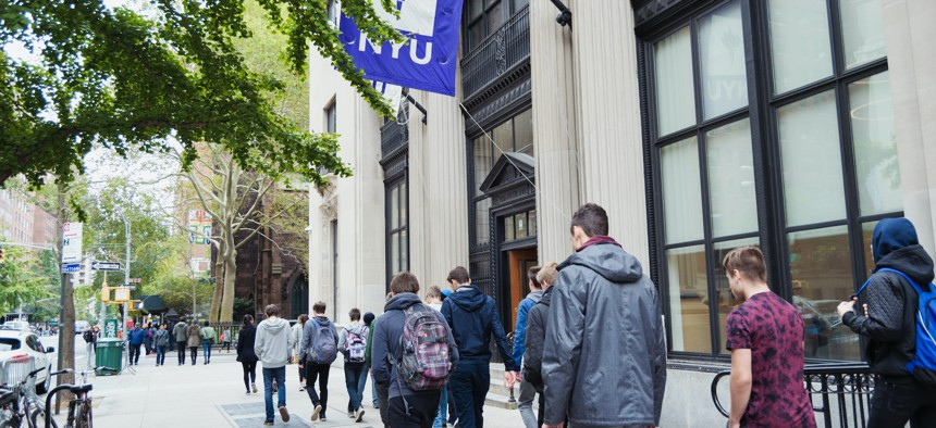 College students walking to class at NYU in 2017.