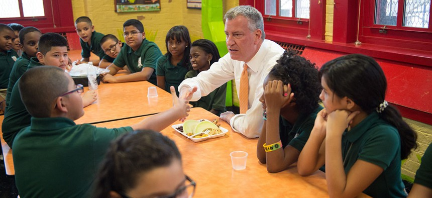 Mayor Bill de Blasio enjoys lunch with students at school.