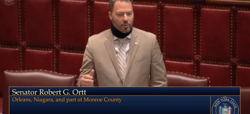 State Senator Robert Ortt protesting the removal of the law banning the wearing of masks in public.