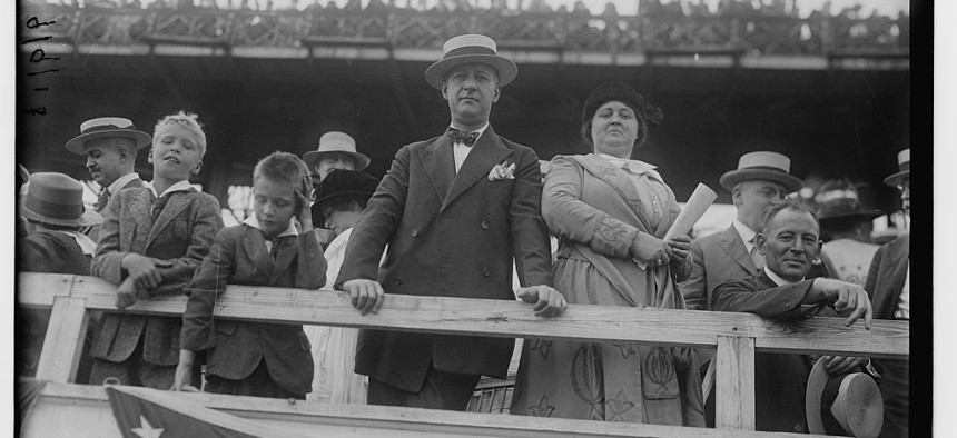 """Former governor and 1913 state Assembly Speaker Alfred Emanuel """"Al"""" Smith, with his wife Catherine and children, at Sheepshead Bay Speedway in August of 1918."""