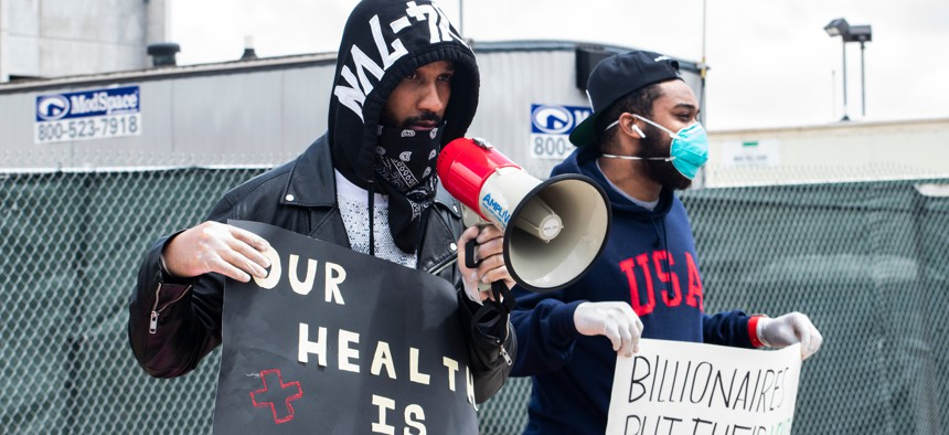 Former Amazon employee Chris Smalls and Amazon employee Jordan Flower at a may day protest in front of the Amazon JFK8 Distribution Center.