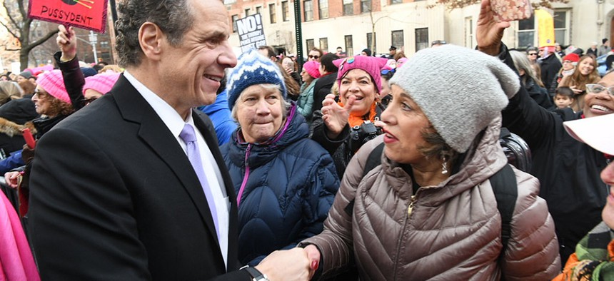 Andrew Cuomo shakes a woman's hand at the Women's March in New York City
