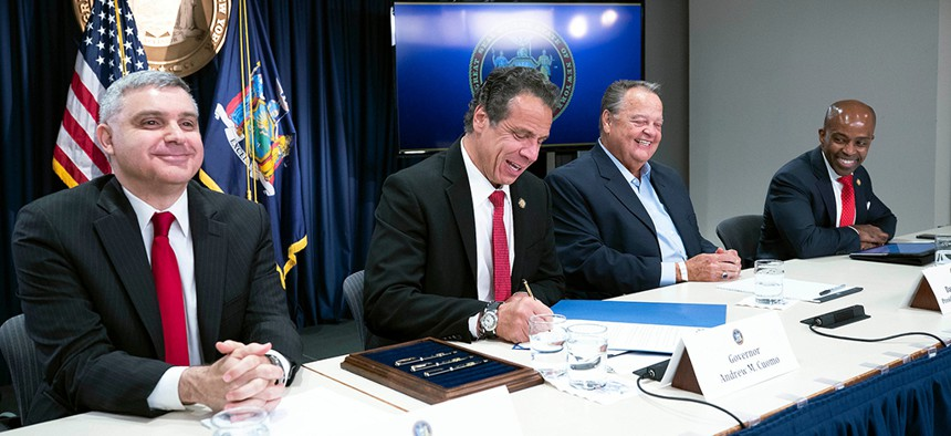 Governor Andrew M. Cuomo signs an executive order to protect union members from harassment and intimidation.