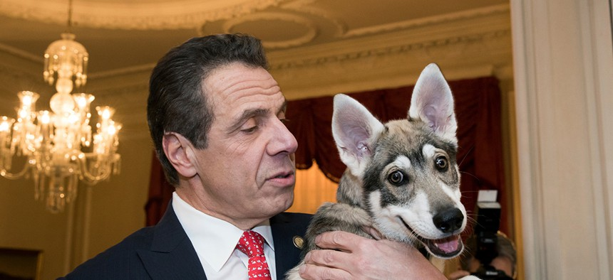 Gov. Andrew Cuomo with his dog Captain.