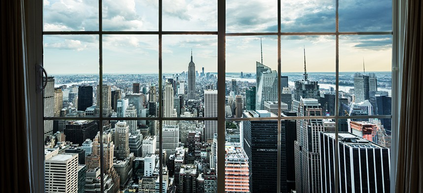 The Manhattan skyline looking out of a high rise window.