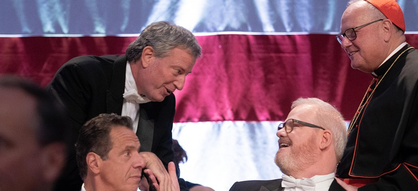 New York City Mayor Bill de Blasio shakes hands with comedian Jim Gaffigan at the 73rd Annual Alfred E. Smith Memorial Foundation Dinner in midtown Manhattan.