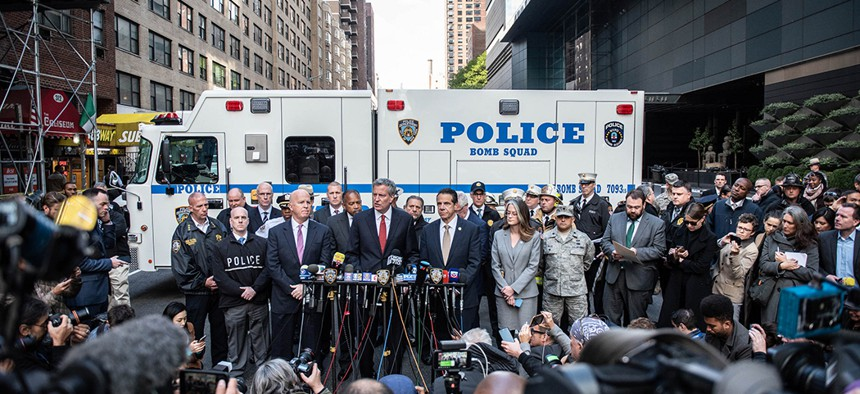 Mayor Bill de Blasio, Governor Andrew Cuomo and Police Commissioner James O'Neill hold a press conference outside the Time Warner Center in Manhattan after the NYPD Bomb Squad removed an explosive device from the building on Wednesday, October 24, 2018.