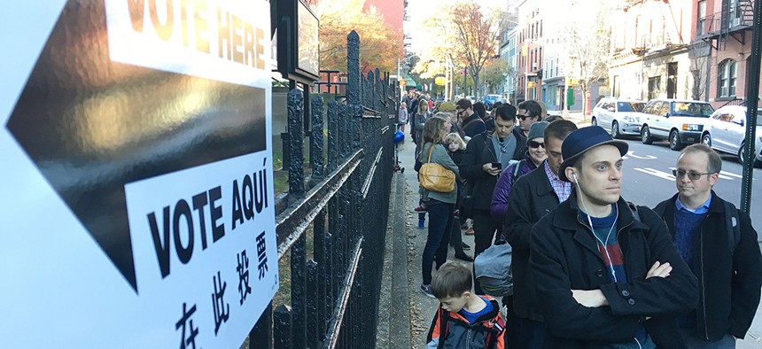 Voters wait in line to cast their ballot during the 2016 election at PS 8 in Brooklyn.