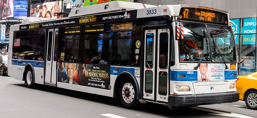 A New York City bus in motion.