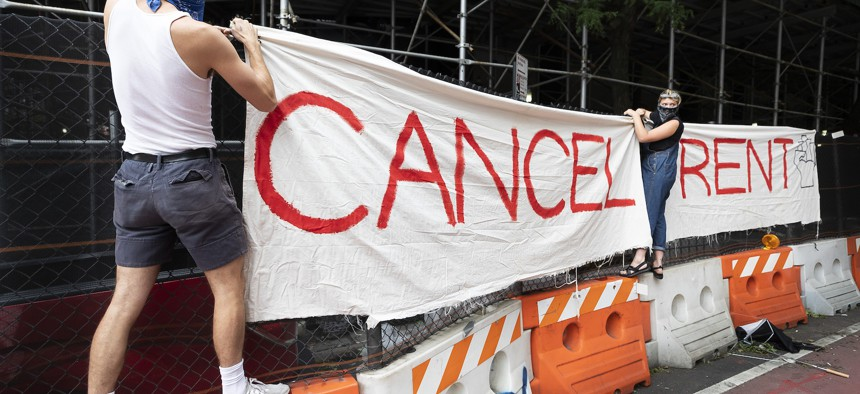 Activists hang a cancel rent sign in New York City on August 6, 2020.