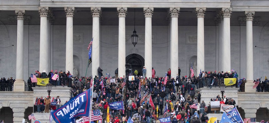 Pro-Trump supporters storm the grounds of the East Front of the US Capitol.