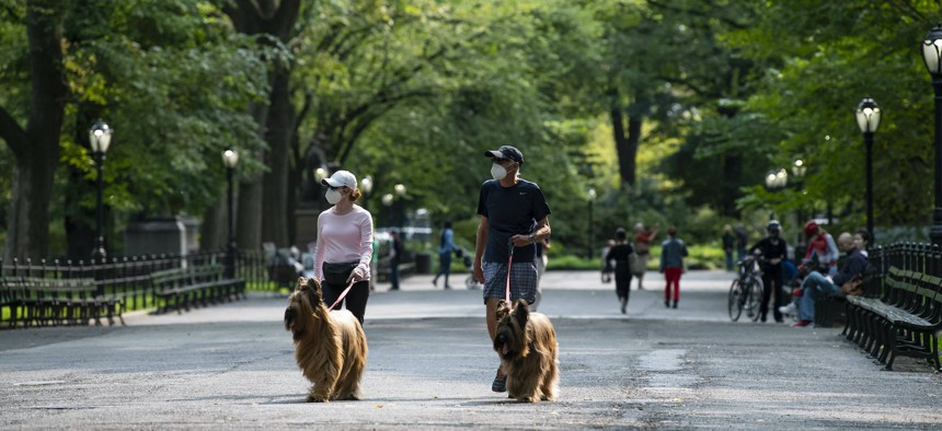 """New Yorkers walk their dogs in the """"Anarchist State"""" of New York City on September 16, 2020."""