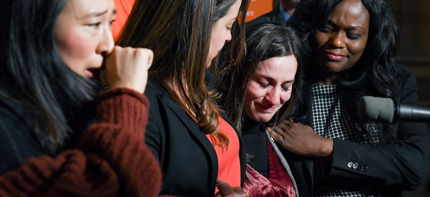 New York State Senator Alessandra Biaggi cries during a press conference marking the one year anniversary of the Child Victims Act.