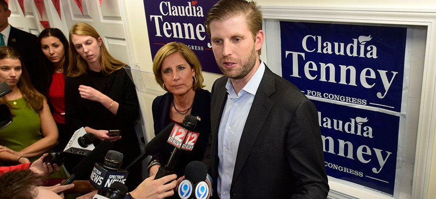 Eric Trump, right, speaks to the press at a rally held for U.S. Rep. Claudia Tenney at her campaign headquarters in 2018.