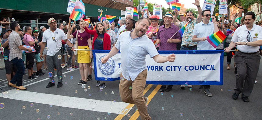 New York City Council Speaker Corey Johnson living his best life marching in Brooklyn's Pride parade.