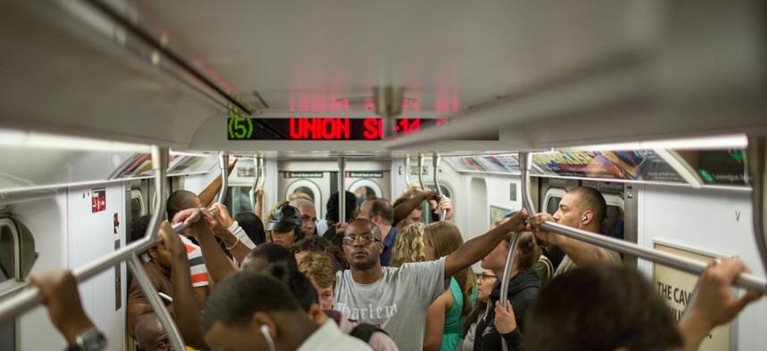 A crowded New York City subway car.