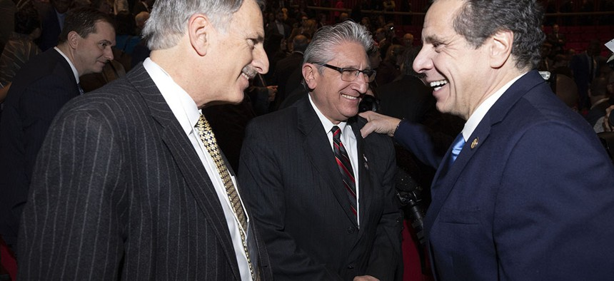 Gov. Andrew Cuomo laughing with Assemblyman David Weprin and state Sen. James Tedisco at his joint State of the State and budget address.