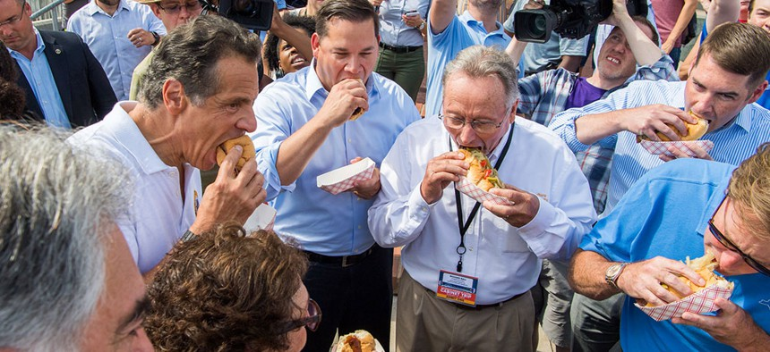 Gov. Andrew Cuomo and company chowing down on some Gianelli sausage.