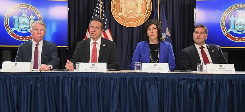 Manhattan District Attorney Cyrus Vance Gov. Andrew Cuomo, Nassau County District Attorney Madeline Singas and Suffolk County District Attorney Timothy Sini.