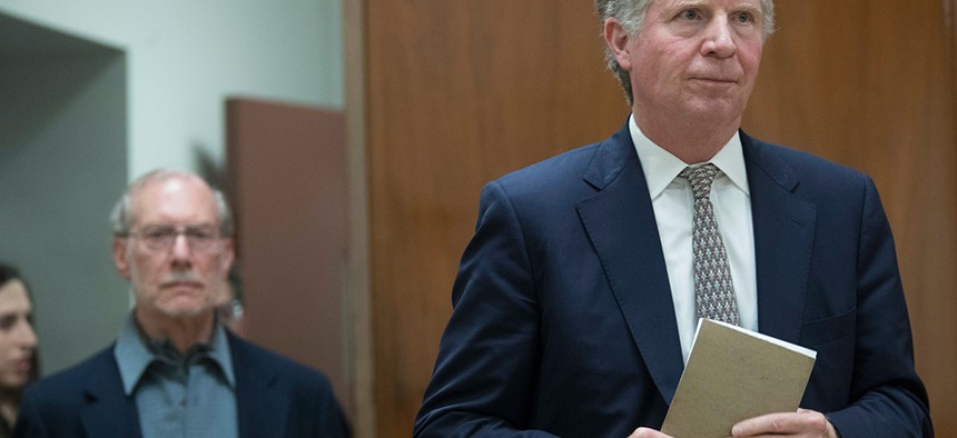 Manhattan DA Cyrus Vance walks out of court