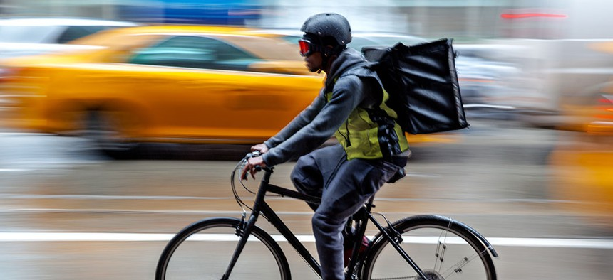 A delivery cyclist.