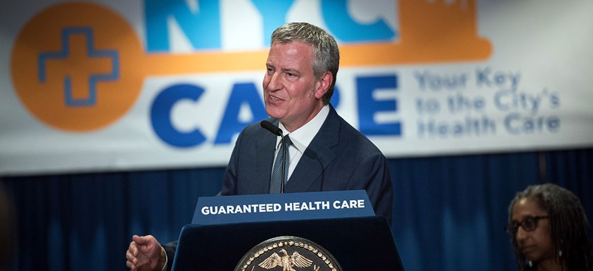 New York City Mayor Bill de Blasio announcing guaranteed health care for New Yorkers in May.