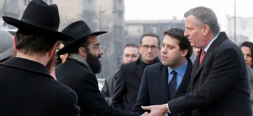 New York City Mayor Bill de Blasio greets Jewish community members.