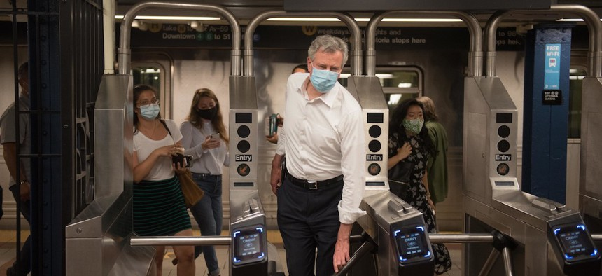 Bill de Blasio takes the subway to celebrate the beginning of Phase 2 on June 23rd.