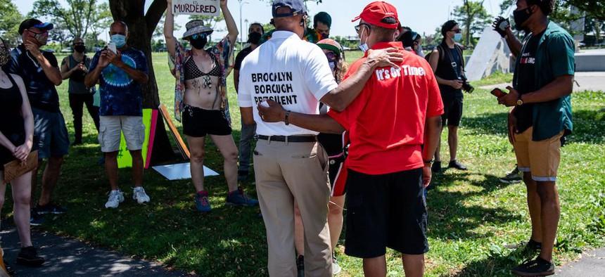 Brooklyn Borough President Eric Adams (left) speaks with Black Lives Matter protestors on July 18, 2020.